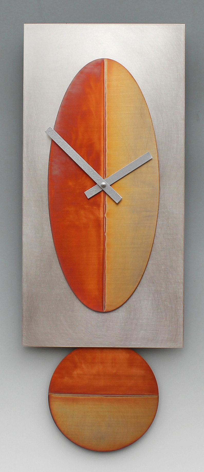 Leonie Lacouette: Steel/Copper Oval Pendulum Wall Clock | Rendezvous Gallery